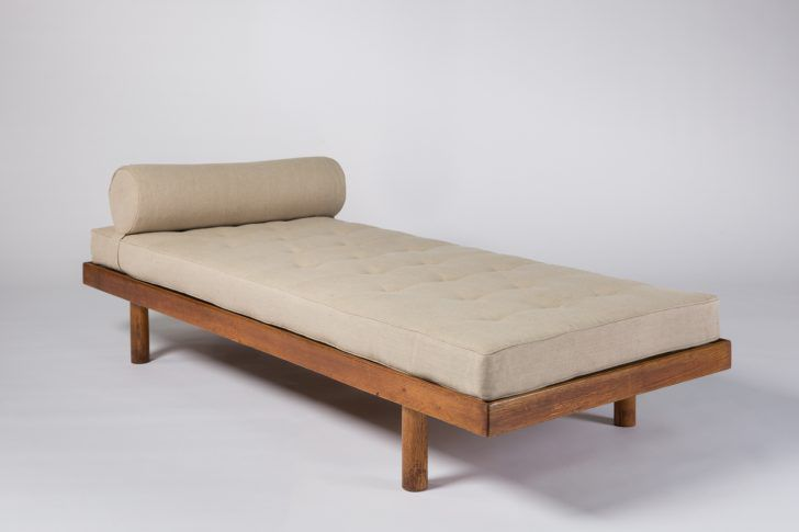 Daybed with cream colored cushion