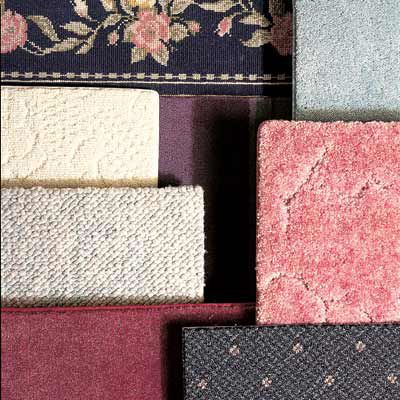 Many different colorful carpet samples next to each other.