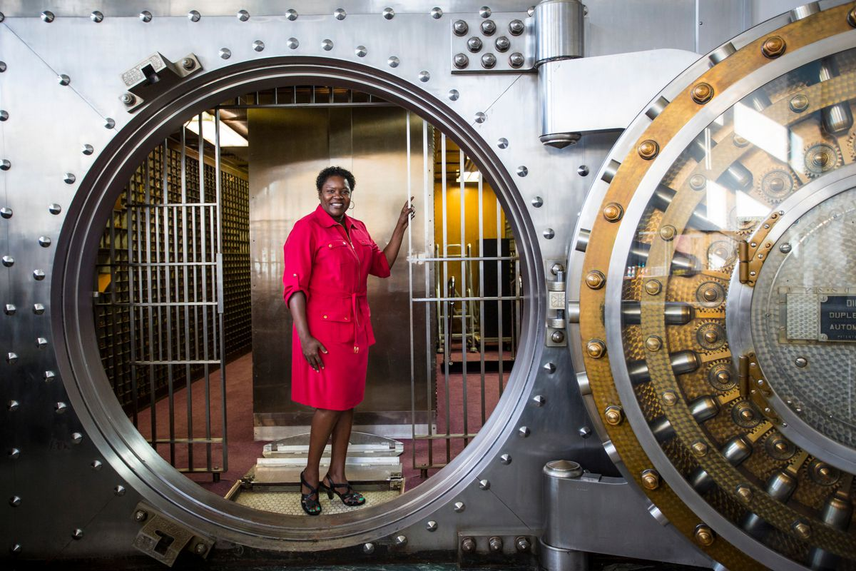 Christie Richardson, regional director of community outreach for Catholic Charities of Chicago, at the Tolton Peace Center. The center, in the Austin neighborhood is in a former bank building, complete with a still-functioning vault that dates to 1913. |
