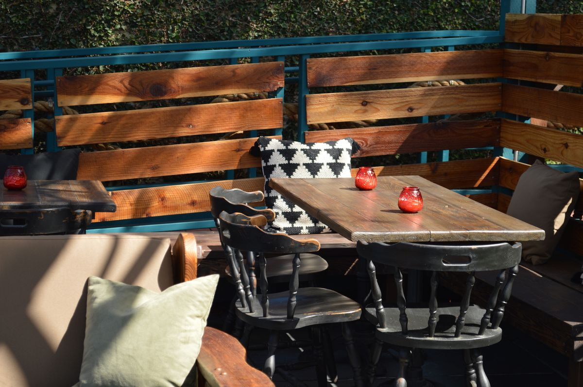 A table with pillows at the Chez Jay back yard.
