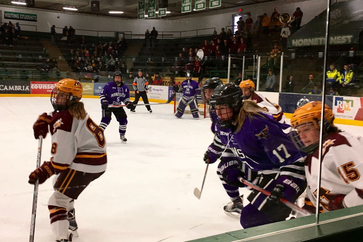 From left to right: Kippin Keller (UMN), Hannah Davidson (MSU), and Paige Haley (UMN) chasing the puck.