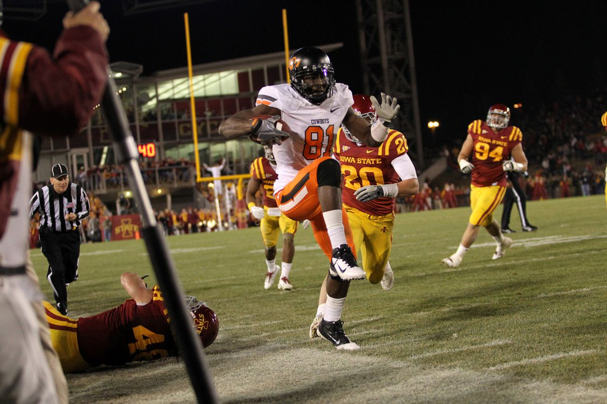 AMES, IA - NOVEMBER 18:  Justin Blackmon #81 of the Oklahoma State Cowboys tries to stay in bounds against the Iowa State Cyclones at Jack Trice Stadium November 18, 2011 in Ames, Iowa.  (Photo by Reese Strickland/Getty Images)