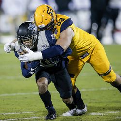 Kent State defensive end Alex Hoag (53) tackles Utah State wide receiver Jordan Nathan (16) during the first half of the Frisco Bowl NCAA college football game Friday, Dec. 20, 2019, in Frisco, Texas.