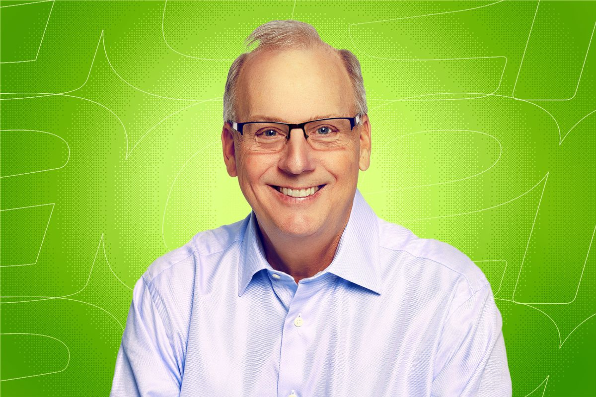 Gregg Prendergast in front of a green background.