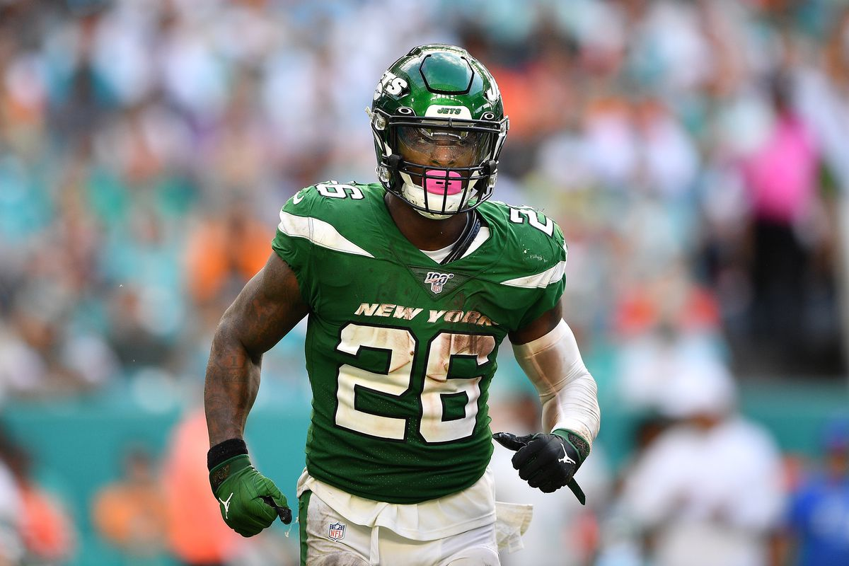 Le'Veon Bell of the New York Jets runs with the ball against the Miami Dolphins in the third quarter at Hard Rock Stadium on November 03, 2019 in Miami, Florida.