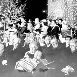 President Ezra Taft Benson and his wife, Flora, sit with other church authorities at the Temple Square lighting ceremony in December 1983.