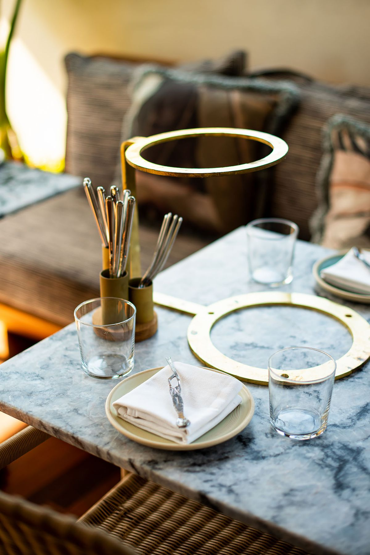 Marble and brass details on a table.