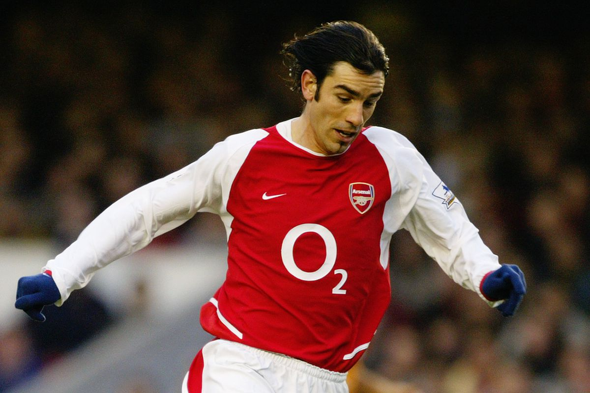 Robert Pires of Arsenal running with the ball