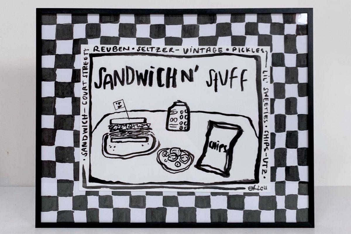 A checkerboard lunch scene artwork framed in a black frame.