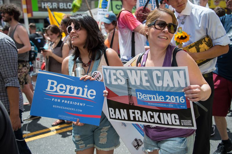 Supporters of former US Democratic presidential candidate Bernie Sanders march in support of clean energy and the environment in Philadelphia on July 24, 2016.