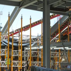 2:09 p.m. Concrete forms being lowered in by crane in right field -