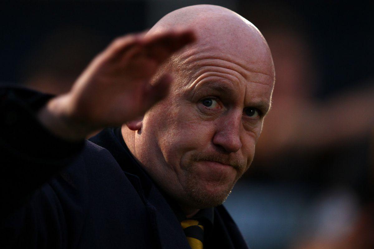 Old bald guy waves goodbye.