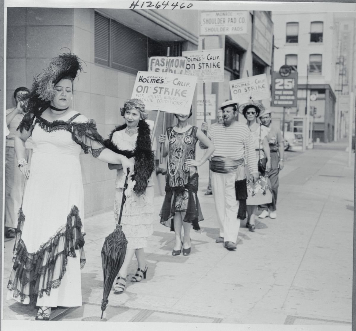 Workers protest in costumes from the 1920s, 1930s, 1940s.