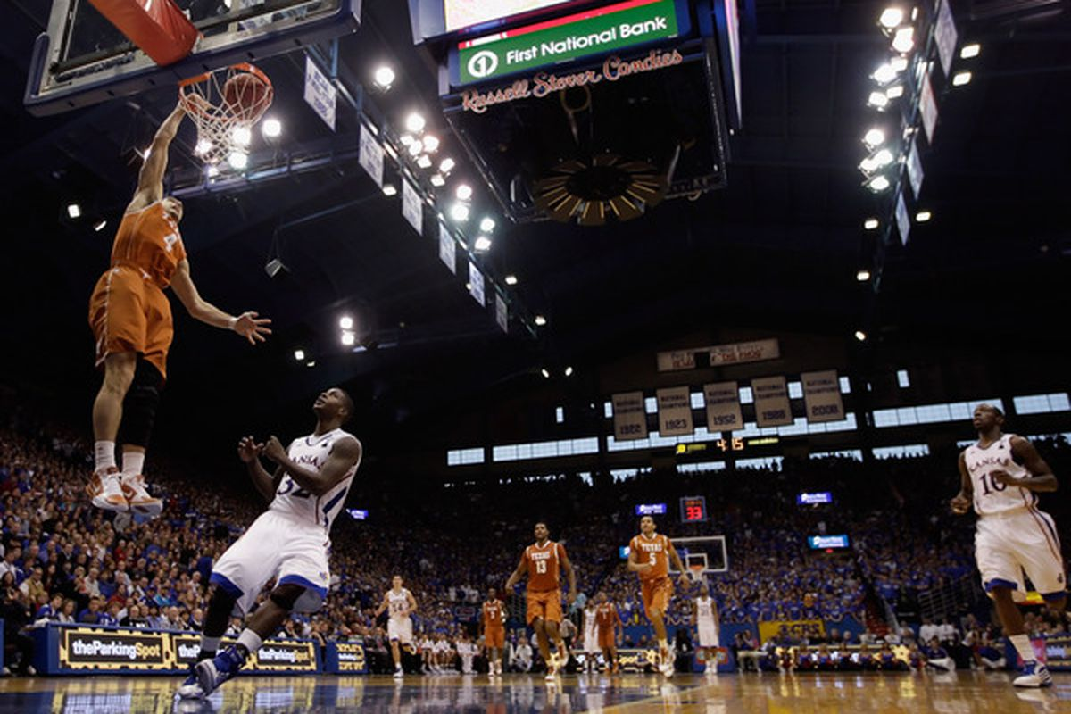 LAWRENCE KS - JANUARY 22:  Dogus Balbay #4 of the Texas Longhorns scores on a fast break during the game against the Kansas Jayhawks on January 22 2011 at Allen Fieldhouse in Lawrence Kansas.  (Photo by Jamie Squire/Getty Images)