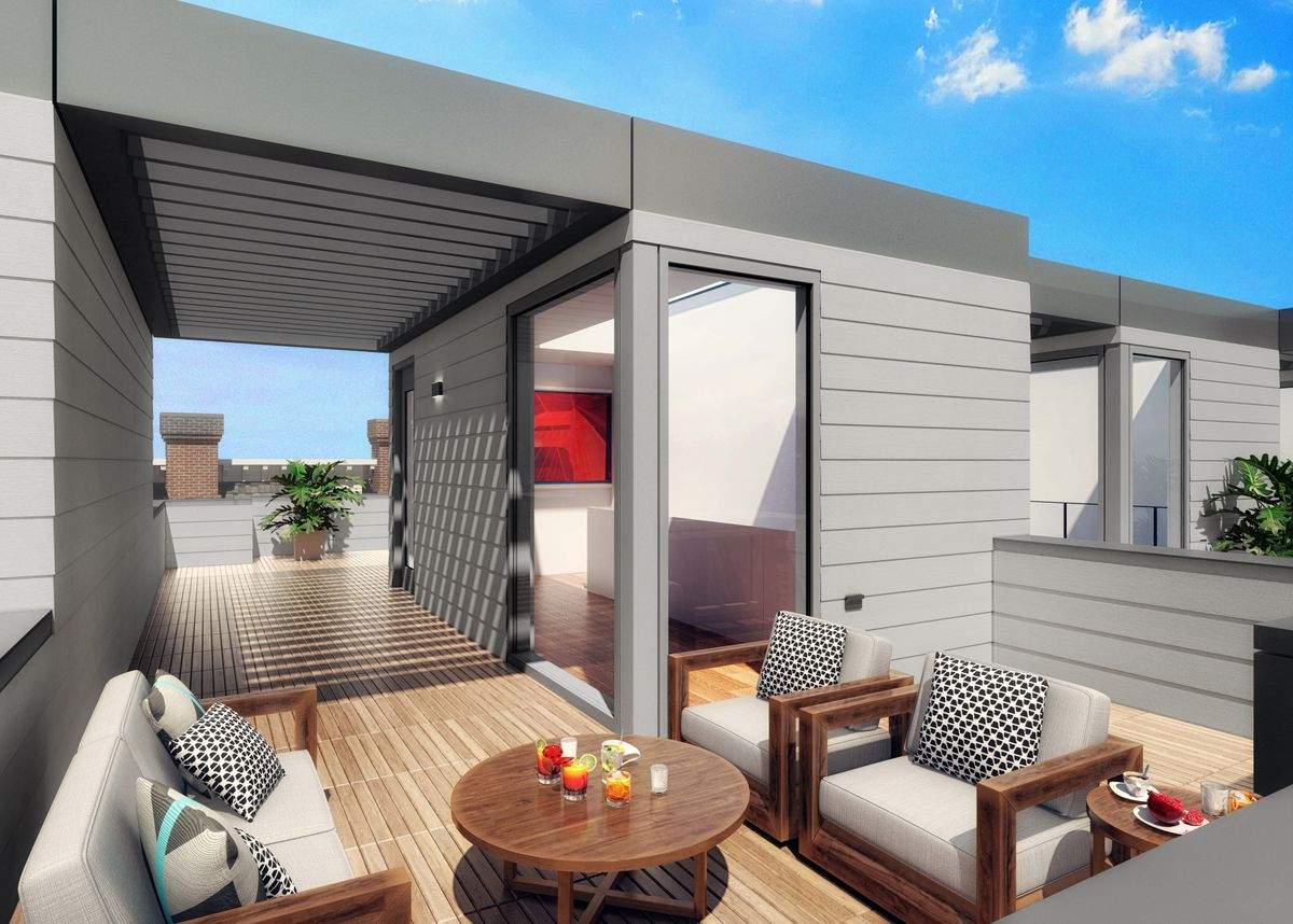 An open deck area connected to a smaller indoor space. There's a low partition separating it from another similar space.