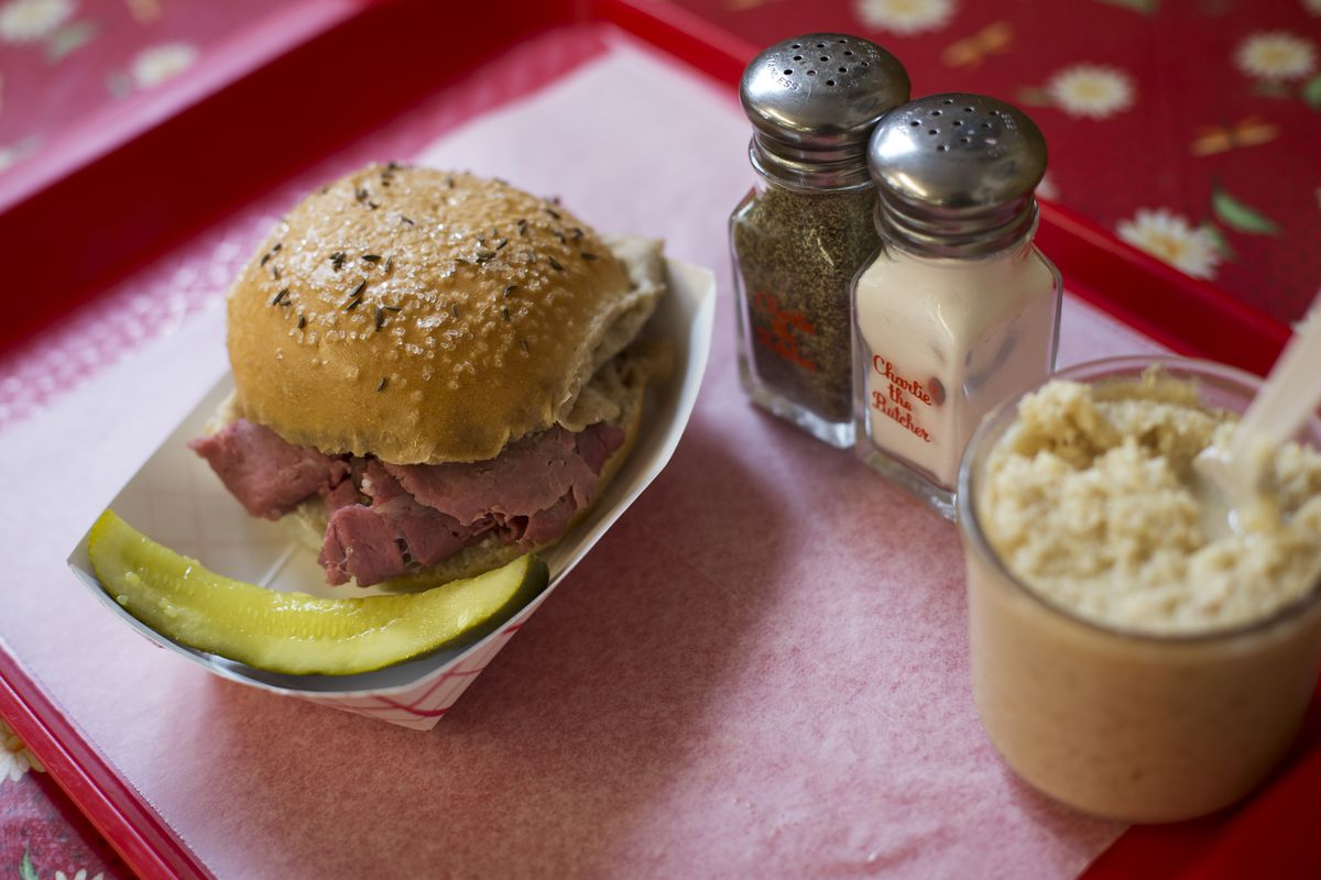 Beef on kummelweck roll on a tray