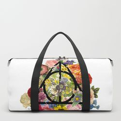 """<a class=""""ql-link"""" href=""""https://society6.com/product/floral-deathly-hallows-black_duffle-bag?sku=s6-7876243p64a210v734"""" target=""""_blank"""">Floral Deathly Hallows Duffle</a>, $50"""