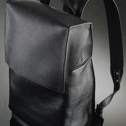"""Balenciaga's black leather backpack. Photo by George Chinsee via <a href=""""http://www.wwd.com/retail-news/department-stores/get-carter-barneys-jay-z-holiday-7183775"""">WWD</a>"""