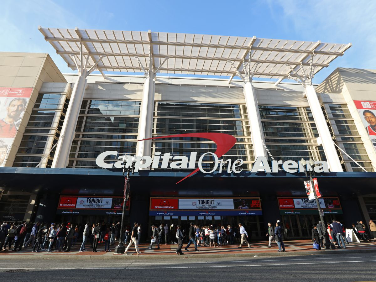 A sports and entertainment arena sponsored by Capital One. The facade is made of glass.
