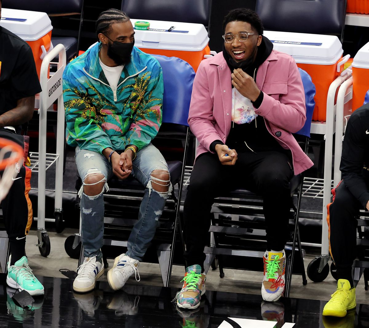 Injured Utah Jazz guards Mike Conley Donovan Mitchell sit on the bench as the Jazz play the Portland Trail Blazers.