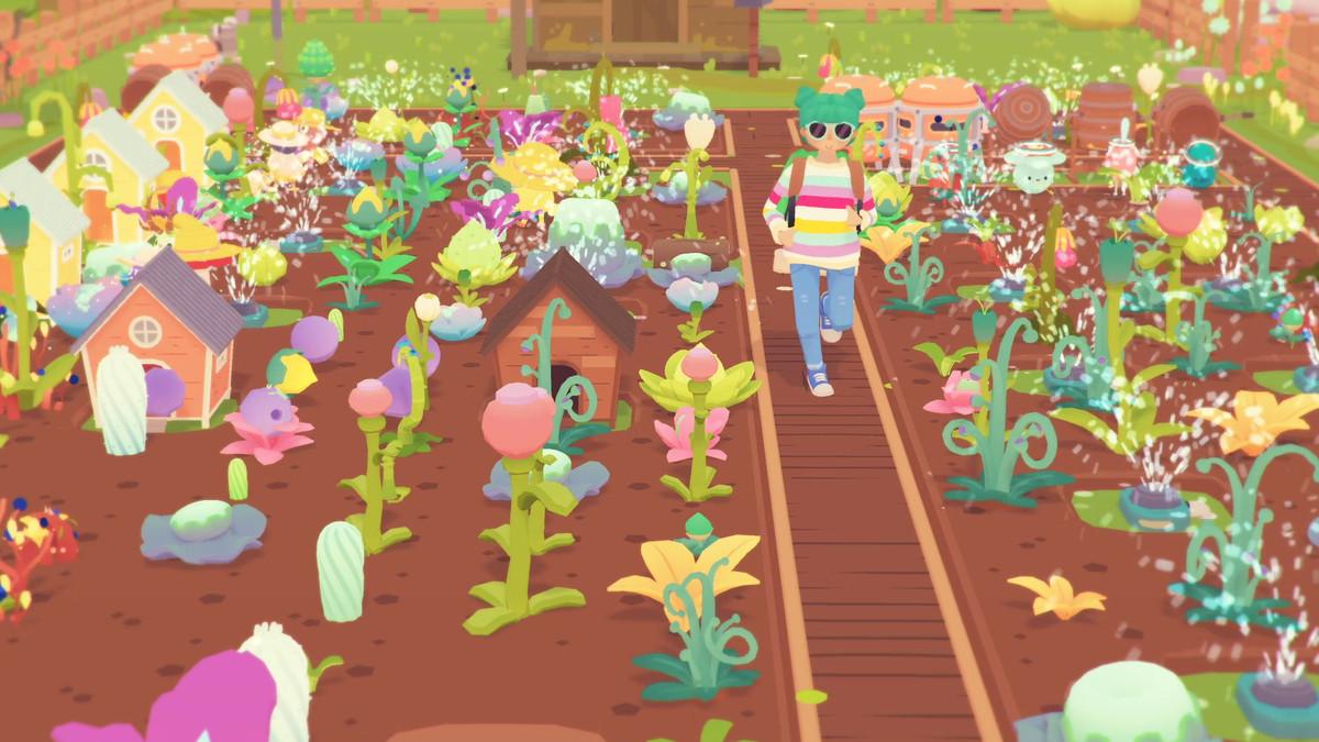 A farmer walks down a farmland covered in colorful plants