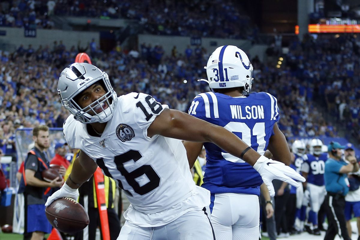 Oakland Raiders wide receiver Tyrell Williams reacts after scoring a touchdown against Indianapolis Colts cornerback Quincy Wilson during the second quarter at Lucas Oil Stadium.