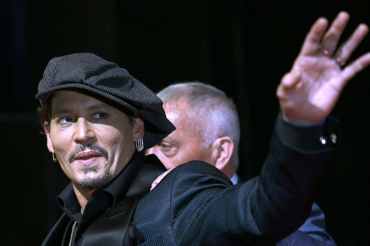 Johnny Depp waves for fans upon his arrival at a film premier in Tokyo in 2017. A new ad for a Dior men's fragrance called Sauvage, in which Depp appears, sparked outrage Friday, Aug. 30, 2019, for its use of Native American culture and symbols.