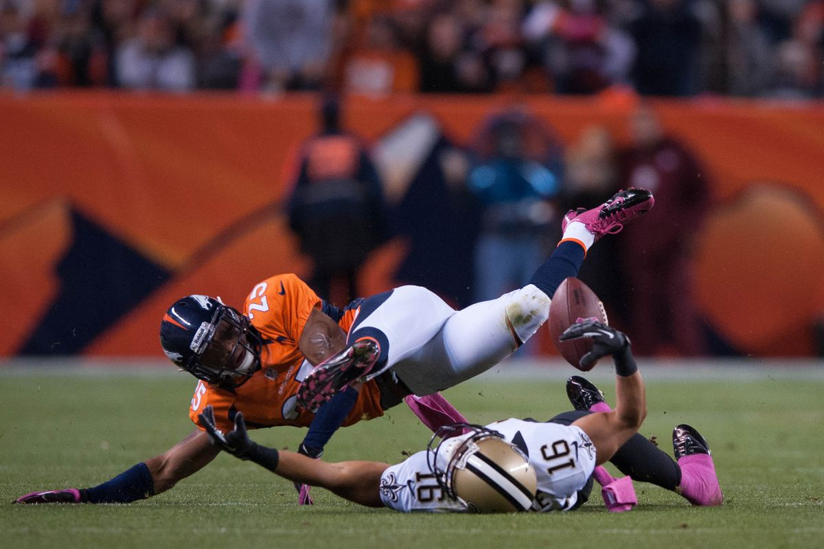 DENVER, CO - New Orleans Saints wide receiver Lance Moore (16) can't separate from Denver Broncos cornerback Chris Harris Jr (25), who breaks up a pass on Sports Authority Field at Mile High Stadium.