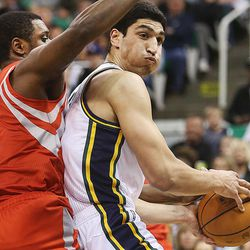 Utah Jazz's center Enes Kanter (0) works agaist Houston's Terrence Jones as the Jazz and the Rockets play Saturday, Nov. 2, 2013 in EnergySolutions arena.