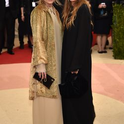 Ashley and Mary-Kate Olsen wear looks by The Row.