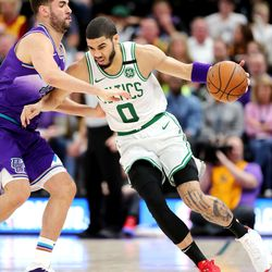 Utah Jazz forward Georges Niang (31) tries to defend Boston Celtics forward Jayson Tatum (0) as the Utah Jazz and the Boston Celtics play an NBA basketball game at Vivint Smart Home Arena in Salt Lake City on Wednesday, Feb. 26, 2020. Boston won 114-103.
