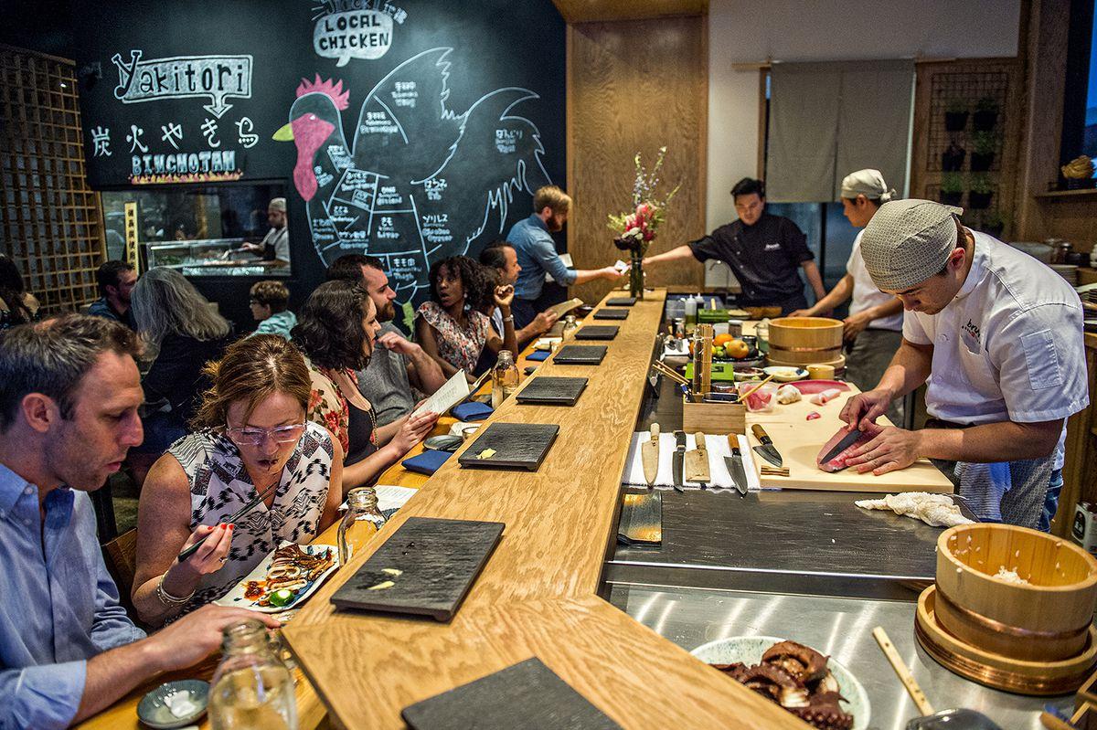 The bustling sushi bar at Brush Sushi Izakaya