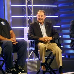 Kalani Sitake, BYU's head football coach, former Gov. Gary Herbert, and Derek Miller, president and CEO of the Salt Lake Chamber and Downtown Alliance, talk during BYU football media day at the BYU Broadcasting Building in Provo on Thursday, June 17, 2021.