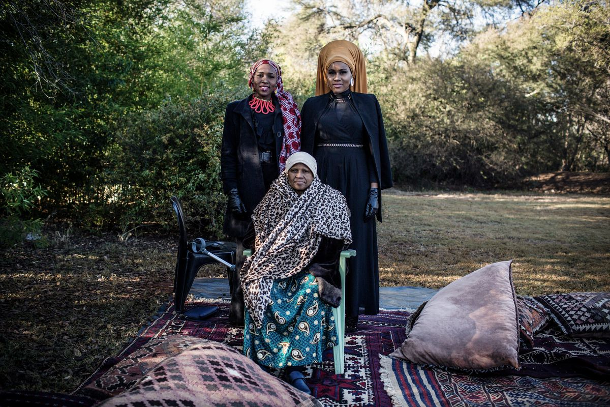June 15: Aisha Mthimkhulu (left), Ameenah Mthimkhulu (right) stand for a portrait with their mother Fatima Mthimkhulu after the Eid-Gah, the prayer on the morning of the Eid Al-Fitr celebration which marks the end of the holy month of Ramadan, at the Raso