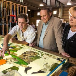 Tom Holdman and Orem philanthropists Marc and Deborah Bingham look at sections of Utah Valley University's 200-foot-long stained glass window installation depicting the history of humanity. The Binghams donated $1.5 million to the project.