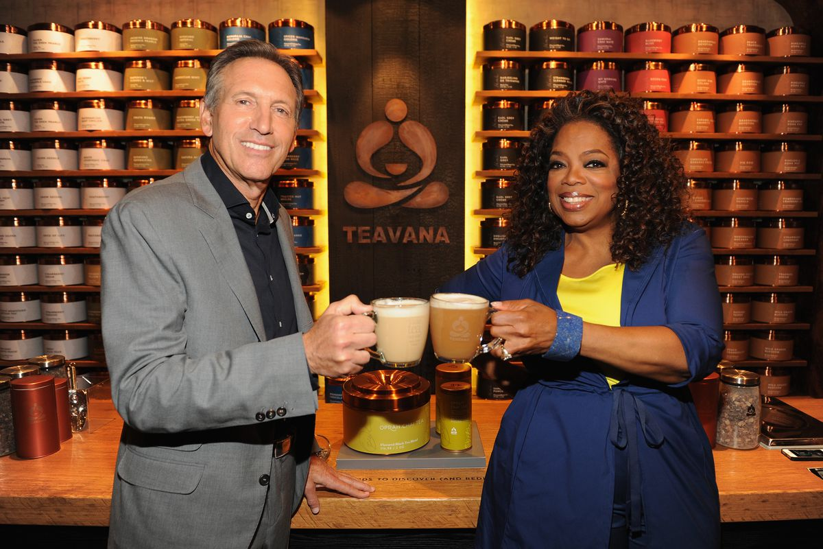 Just two massively wealthy CEOs, sharing a cup of tea. (The one you don't recognize is Howard Schultz.)