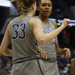 UConn�s Katie Lou Samuelson (33) is greeted by Azura Stevens (23) after being fouled during the Notre Dame Fighting Irish vs UConn Huskies women's college basketball game in the Women's Jimmy V Classic at the XL Center in Hartford, CT on December 3, 2017.