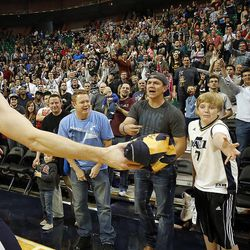 Gordon Hayward gives a signed jersey to a fan following the Utah Jazz's scrimmage in Salt Lake City, Saturday, Oct. 5, 2013.