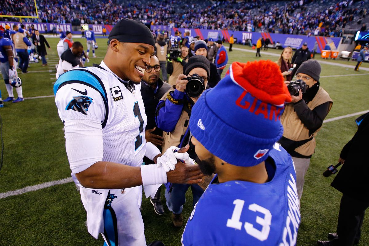 Cam Newton #1 of the Carolina Panthers shakes hands with Odell Beckham #13 of the New York Giants after their game at MetLife Stadium on December 20, 2015 in East Rutherford, New Jersey. The Carolina Panthers defeated the New York Giants with a score of 38 to 35.