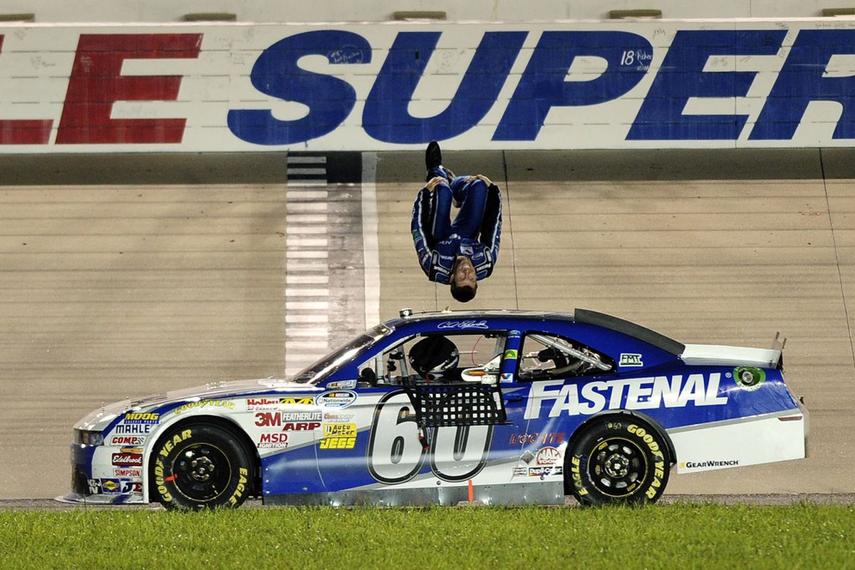 Carl Edwards does a backflip to celebrate winning the NASCAR Nationwide Series Federated Auto Parts 300 on Saturday at Nashville Superspeedway. (Photo: Jared C. Tilton/Getty Images for NASCAR)