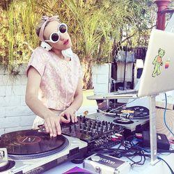 <b>DJ Mia Moretti</b> bringing the beats while looking pretty in pink.