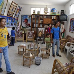 Palestinian children visit the home of Sheik Ahmed Yassin, Hamas founder and spiritual leader, in Gaza City, Monday, May 30, 2011.  Hamas and the family opened Yassin's home to visitors, turning the location into a heritage site. Yassin was killed in an Israeli airstrike in 2004.