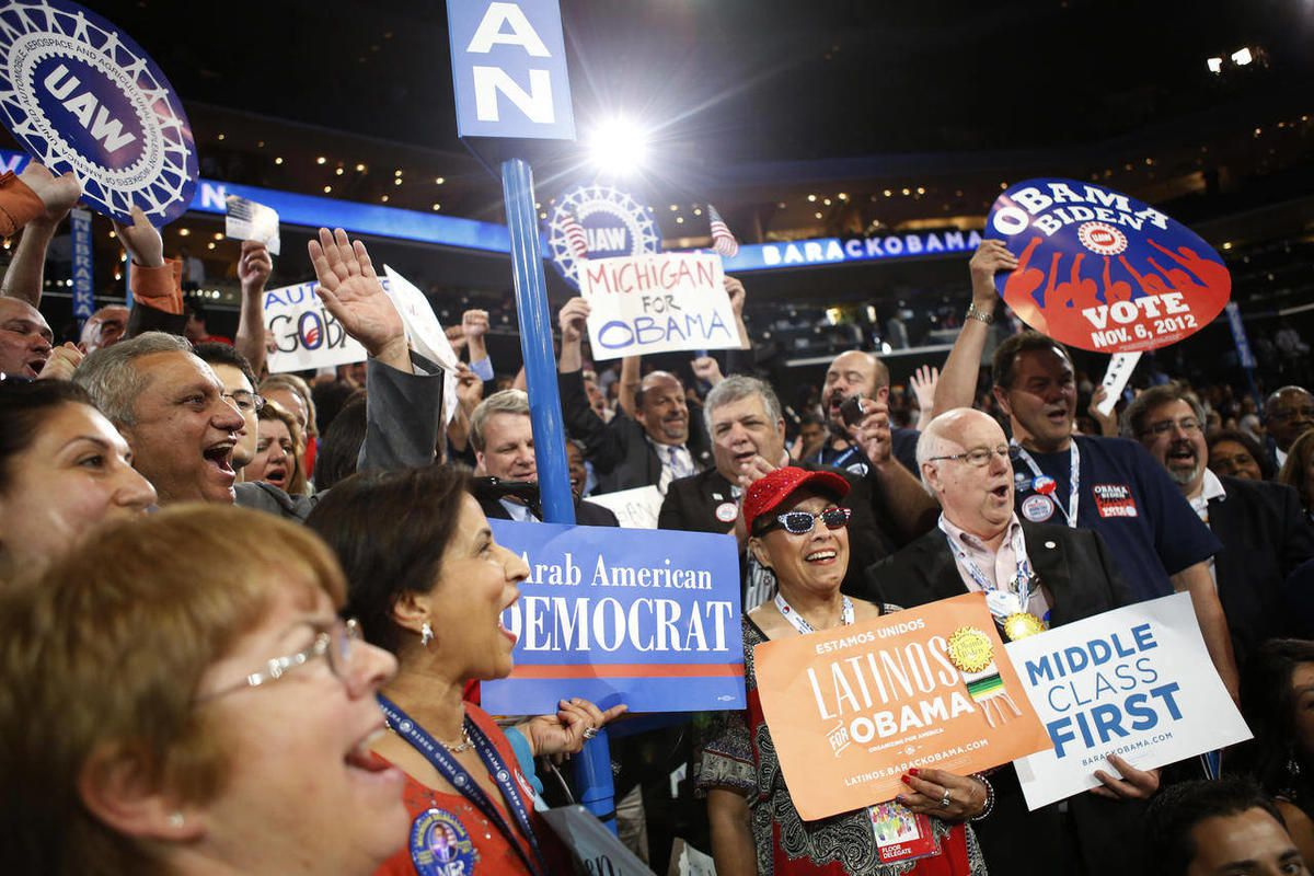 Michigan delegates react as President Barack Obama is nominated for the Office of the President of the United States at the Democratic National Convention in Charlotte, N.C., on Thursday, Sept. 6, 2012.