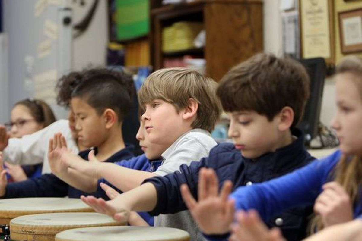 In this 2016 photo, students play tubanos during music class at the University of Memphis Campus School. The university wants to add a middle school.
