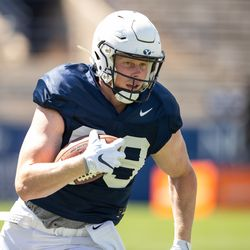 BYU tight end Matt Bushman runs with the ball during the Cougars' practice Wednesday, Aug. 21, 2019 at LaVell Edwards Stadium in Provo.