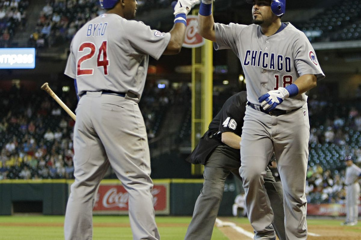 Geovany Soto of the Chicago Cubs receives a high five from Marlon Byrd after hitting a home run in the fourth inning against the Houston Astros at Minute Maid Park in Houston, Texas.  (Photo by Bob Levey/Getty Images)