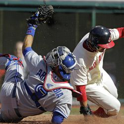 Toronto Blue Jays catcher J.P. Arencibia (9) tags out Cleveland Indians' Shin-Soo Choo trying to score on a passed ball in the third inning of a baseball game in Cleveland on Thursday, April 5, 2012.
