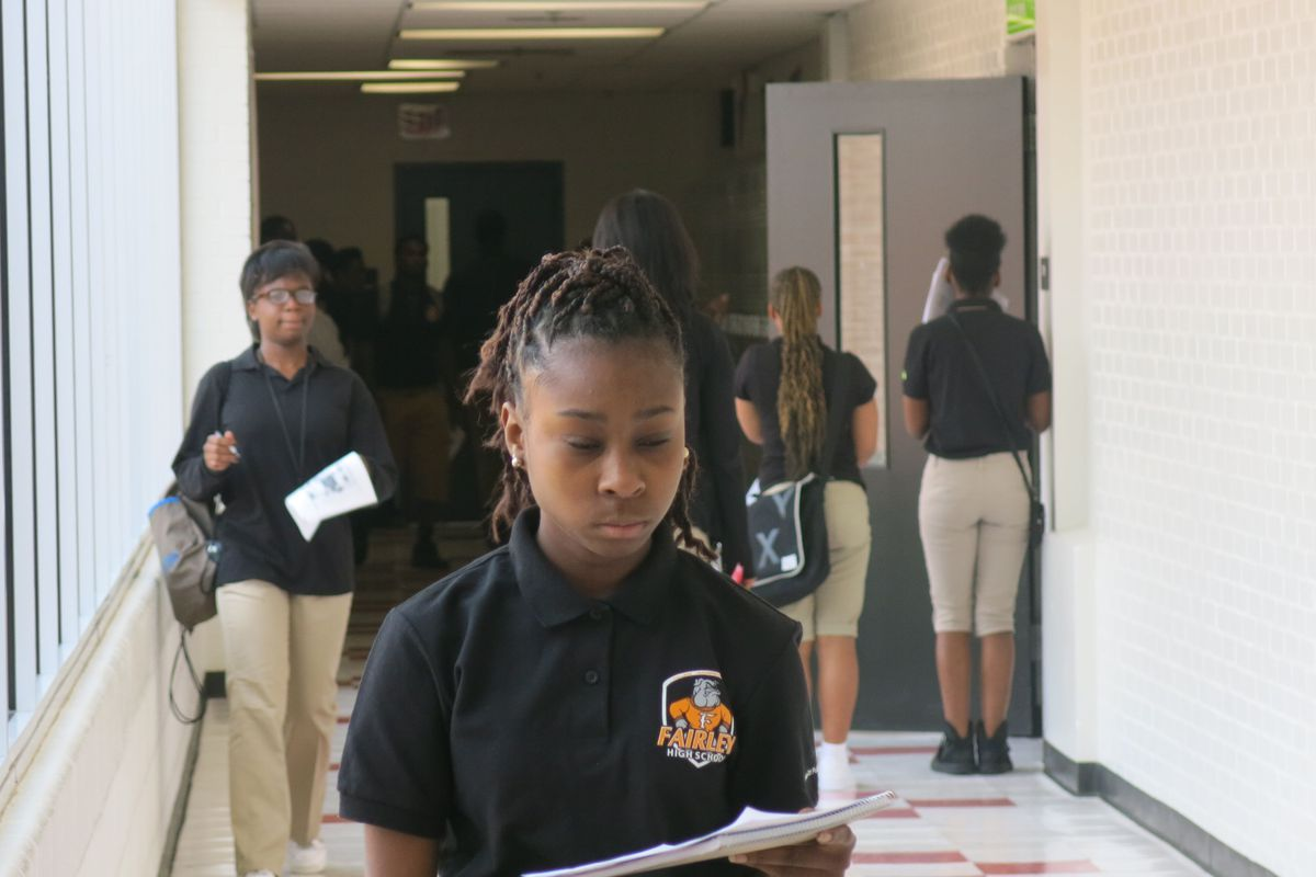 Students check their schedules during a transition at Fairley High School.