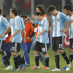 Argentina's players leave the field at the end of a 2014 World Cup qualifying soccer game with Peru in Lima, Peru, Tuesday, Sept. 11, 2012. Lionel Messi is third from right.