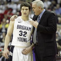 BYU basketball coach Dave Rose talks with guard Jimmer Fredette during the MWC tournament in Las Vegas on Thursday, March 10, 2011.